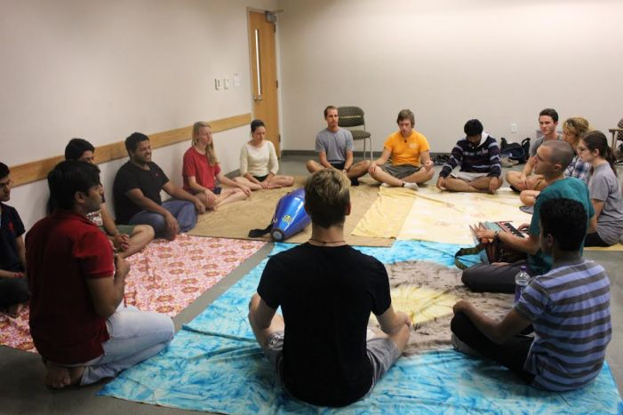 Bhakti yogis absorbed in kirtan